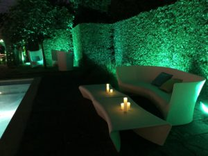 Contemporary white chill out furniture and green garden lighting