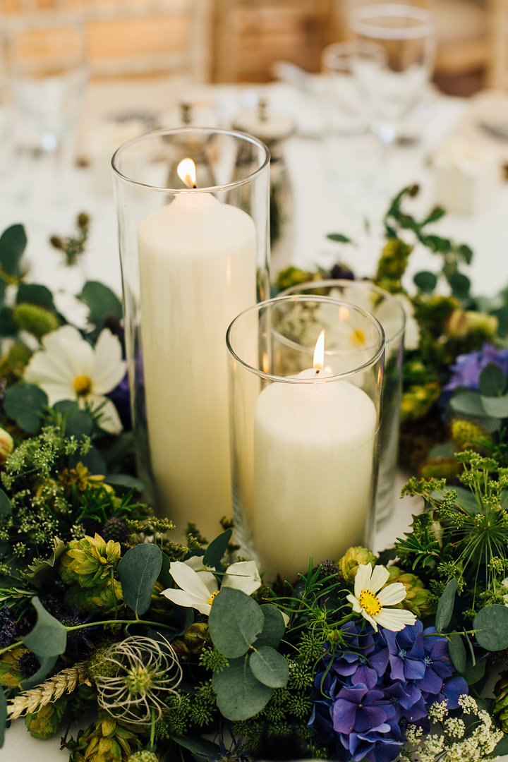 Table centres - draught proof candles suitable for an open sided marquee