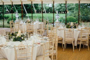 Ivory shabby chic chivari chairs in traditional pole tent
