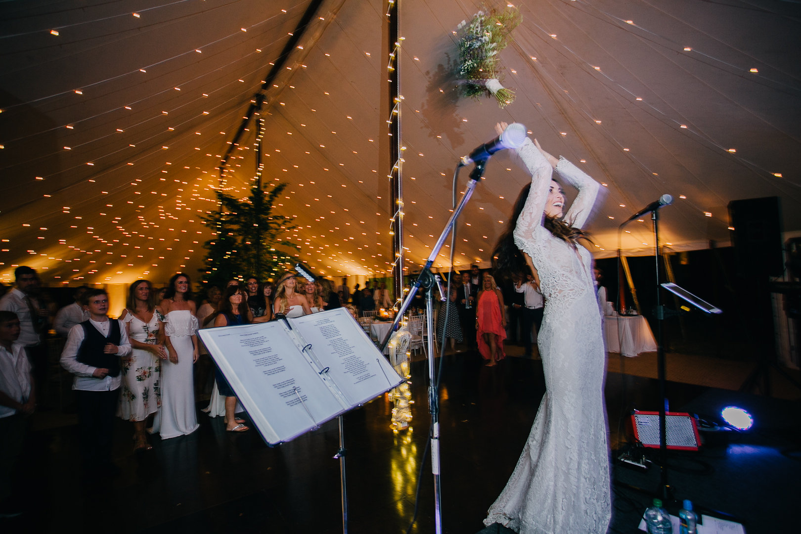 The bride throwing her bouquet in a pealit marquee!